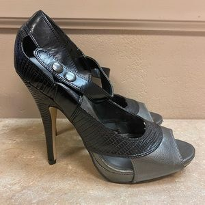 Strappy silver and black heels